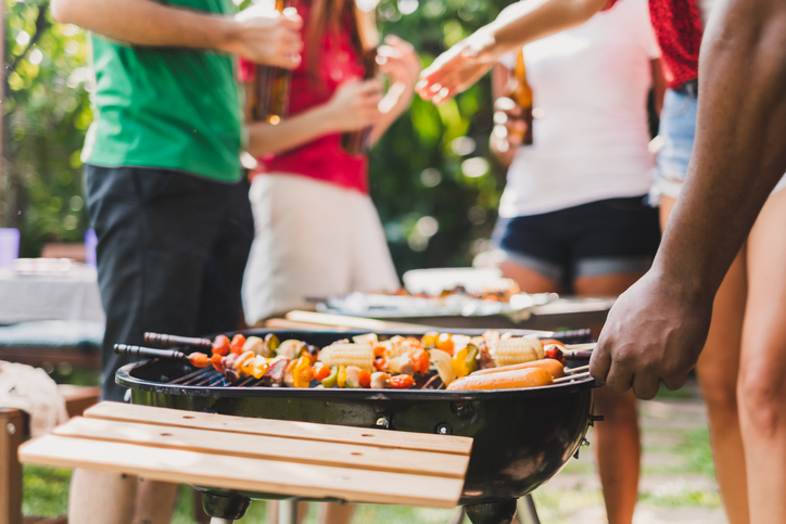 Group of deversity people having barbecue/barbeque party at home, cooking grilled meat/beef for lunch, happy friends party lifestyle concept