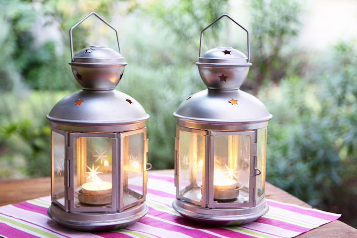 Two lanterns on a table at the garden