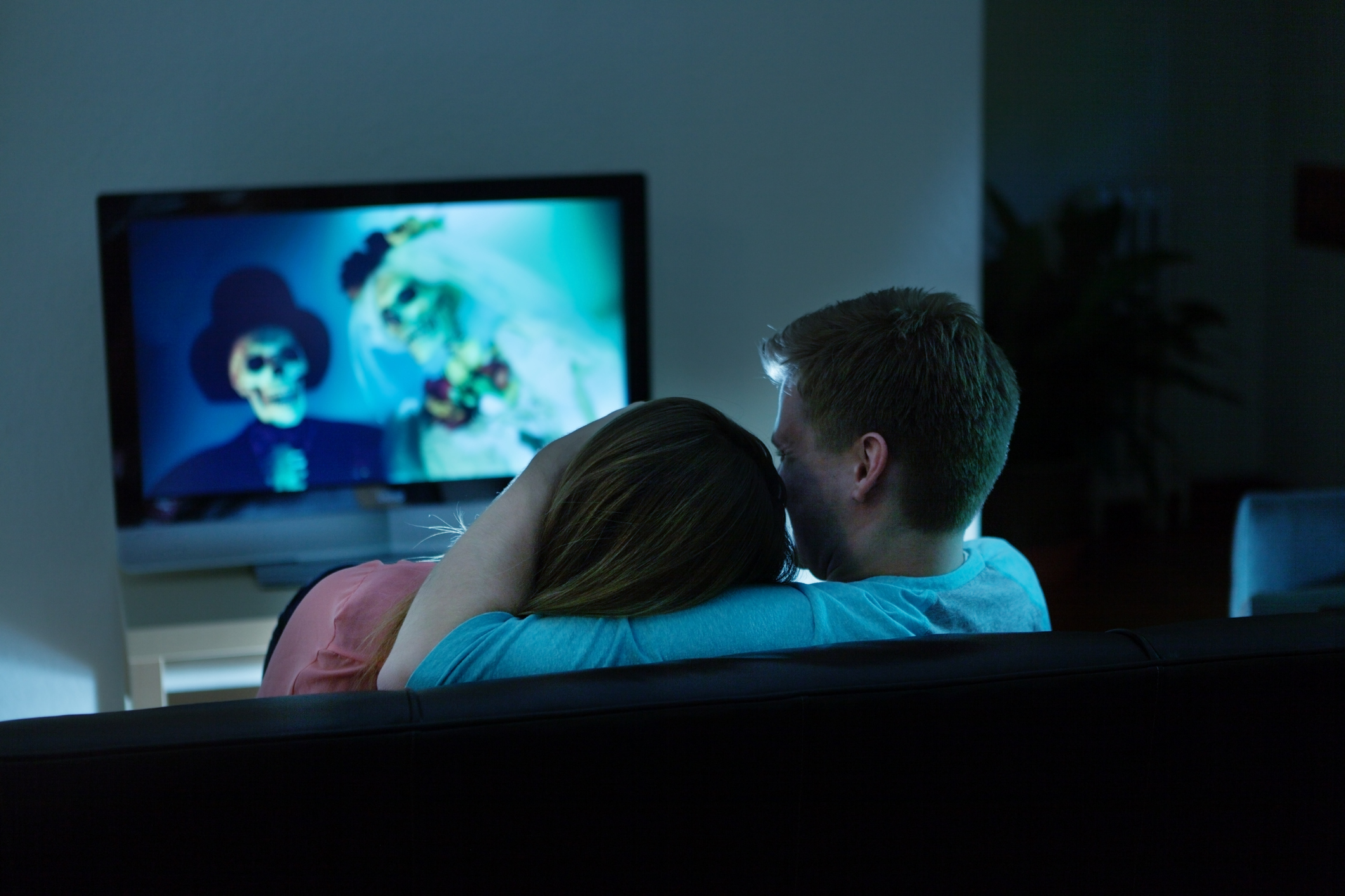 Couple Watching Scary Halloween Movie Together on TV