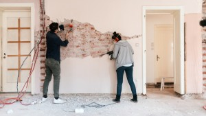 Couple working on reconstruction of their apartment