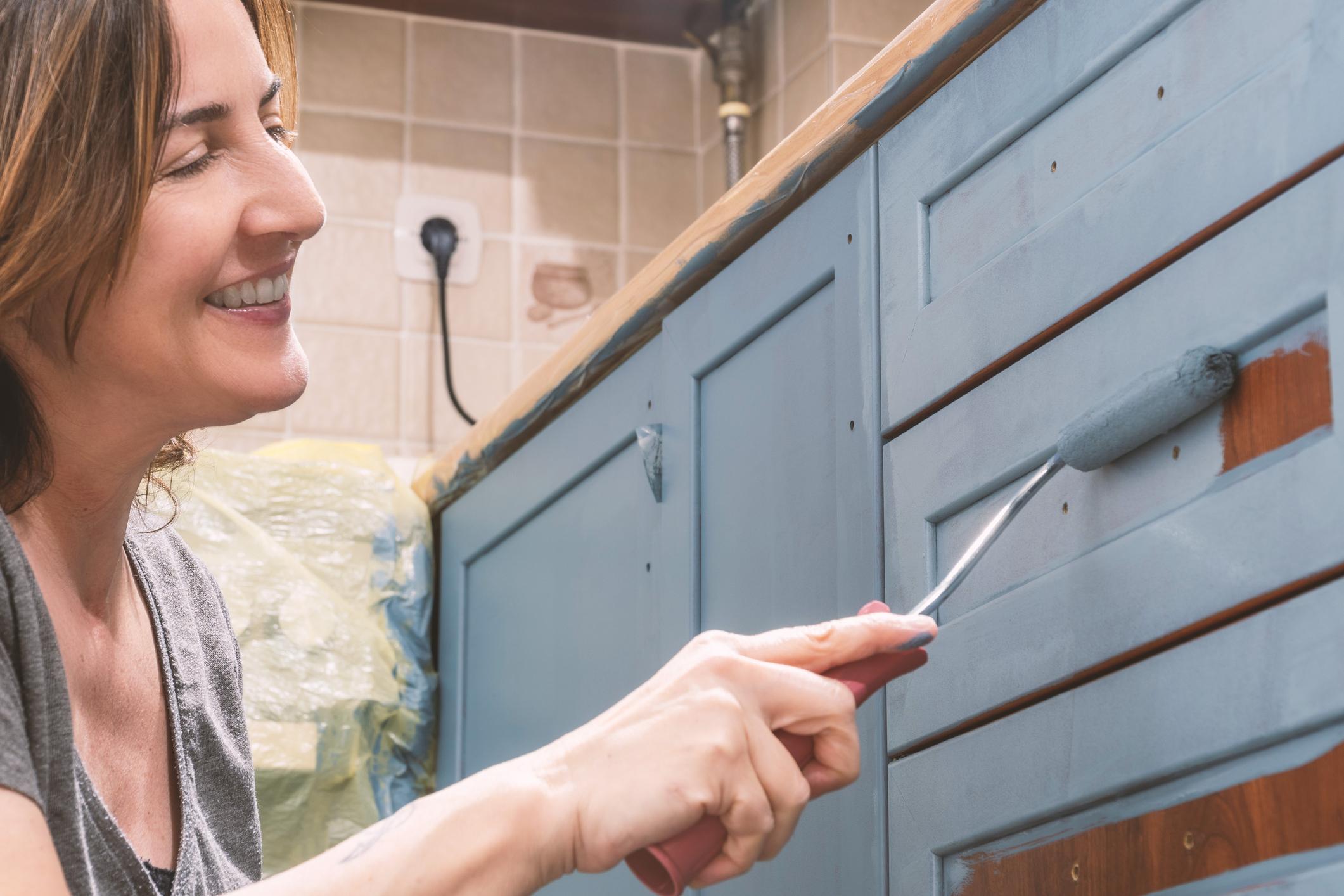 Painting kitchen.