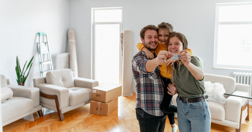 holding keys of their new home