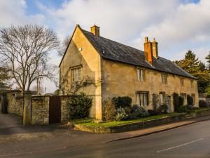 old medieval cottage cotswolds england UK